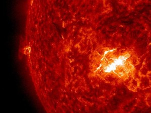 This strong solar flare Wednesday is part of an ongoing solar storm that is bombarding earth with charged, magnetic particles today. NASA Solar Dynamics Observatory